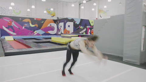 Young Male Freerunner Performing Acrobatic Elements Live Action