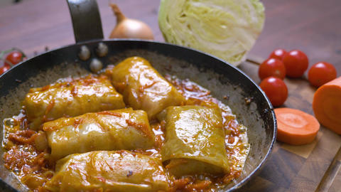 Appetizing freshly cooked cabbage rolls in the pan Live Action