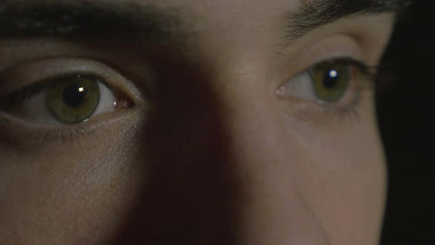4k UHD - Close-up of a young man eyes in the dark Footage