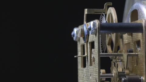 Close-up macro of a vintage clock mechanism running Footage