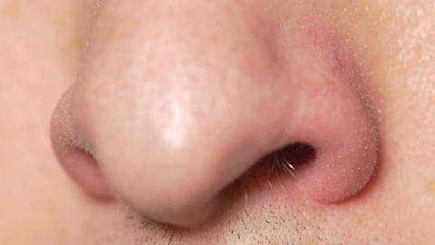 Close-up of male nose sniffing Footage