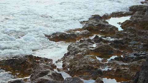 Tide waves on rocky shore, calm stony coastline, tranquil landscape, meditation Footage