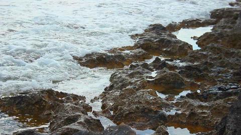 Tide waves on rocky shore, calm stony coastline, tranquil landscape, meditation Footage