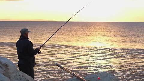 Man fishing at seaside, enjoying tranquil hobby on… Stock Video Footage