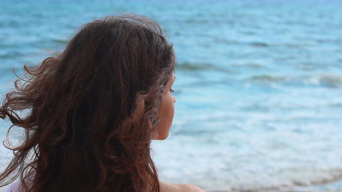Beautiful woman with naked shoulders looking at sea, relax at resort, panorama Footage