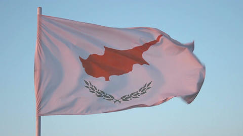 Flag of Cyprus flapping in wind, national symbol against blue sky, loopable shot Footage