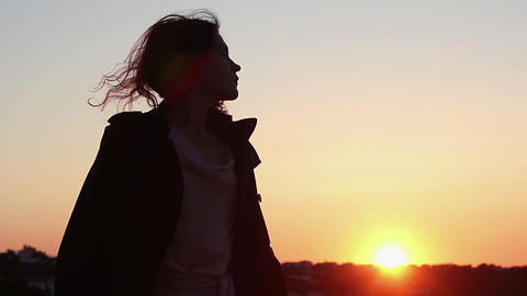 Beautiful woman dancing in sunset, silhouette of drunk female moving to music Live Action