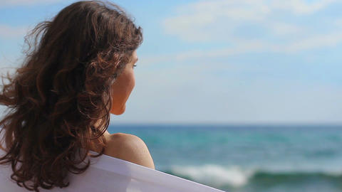 Pretty brunette with happy face enjoying sunny weather at seaside, smile, resort Footage