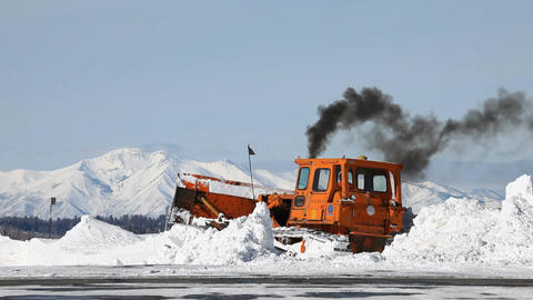 Snow plow cleaning mountain road P HD 6303 Footage
