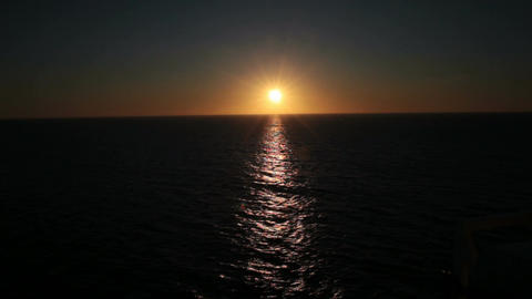 Sunset over ocean from ship P HD 4325 Live Action