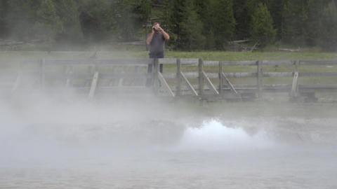Tourist video camera Yellowstone steam bubbler geyser 4K Footage