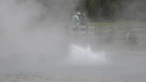 Tourists boardwalk Yellowstone bubbler geyser 4K Footage