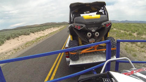 Towing off road recreation vehicles truck trailer POV HD Footage