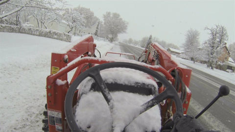 Tractor on road clearing snow after blizzard Point Of View HD 009 Footage