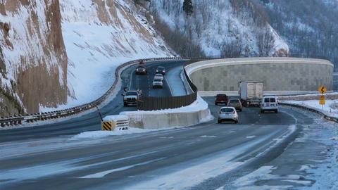 Traffic trucks cars mountain winter highway travel HD 0226 Footage