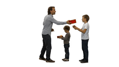 Father giving the gifts to his sons, alpha channel Footage