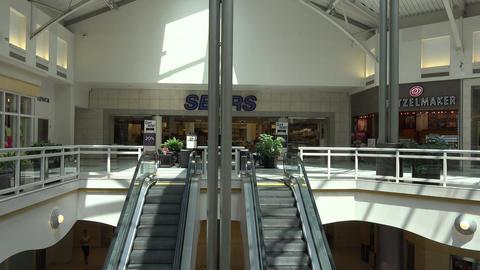 Urban shopping mall escalator to second floor 4K 125 Footage