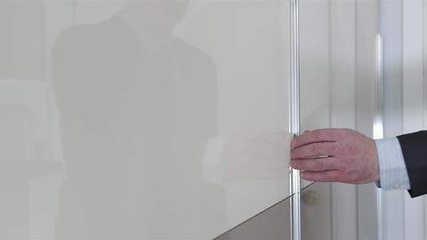 hand opens a sliding door wardrobe close up. The closet door opens Live Action