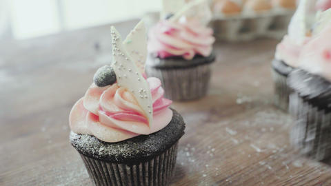 Cupcakes with cream. Butter cream on tasty muffins GIF