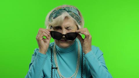 Elderly stylish trendy grandmother. Caucasian woman posing. Chroma key Live Action