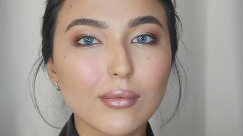 Closeup view of woman face with makeup ライブ動画