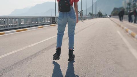 Young bright woman roller skating ライブ動画