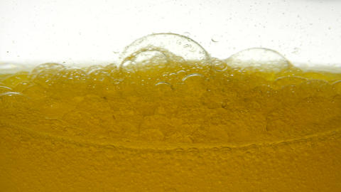 A close-up view of unrefined sunflower oil for nutrition, which from stirring Live Action