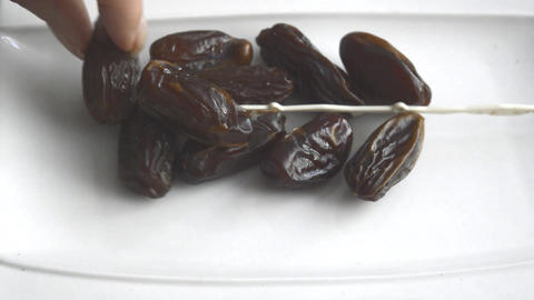 Dryed Dates on a white plate Live Action