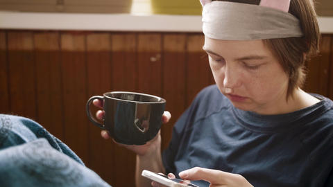 Beautiful young woman holding coffee and using her cellphone to call someone Live Action