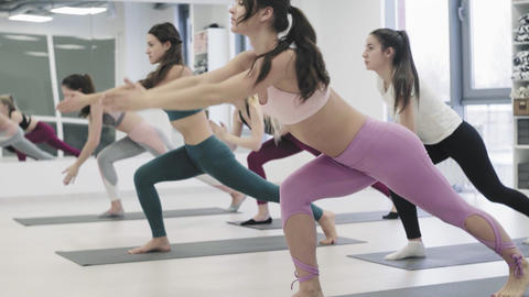 Yoga class group of women exercising healthy lifestyle in fitness studio yoga Live Action