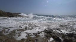 Waves splash at rocky shore Live Action