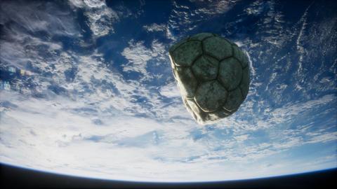 old soccer ball in space on Earth orbit ライブ動画