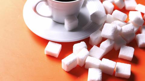 sugar cube in a a tea cup on orange background ライブ動画
