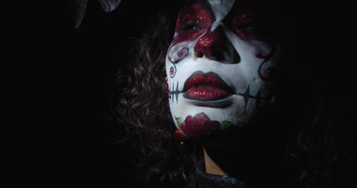 Colorful face paint of a skull on the face of a young mexican woman, 4k Live Action