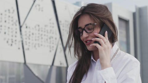 Smiling attractive business woman using smartphone Live Action