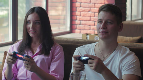 Man and his girlfriend playing playing tv game and have fun Live Action