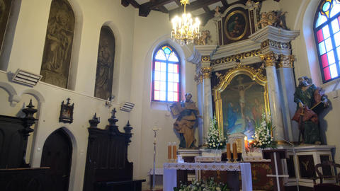 Small Catholic church with paintings and statues inside Live Action