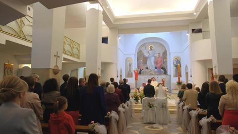 Catholic church. Church wedding ceremony. Priest is praying Live Action