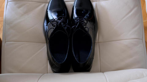 Top view over beautiful patent leather shoes of the groom Live Action