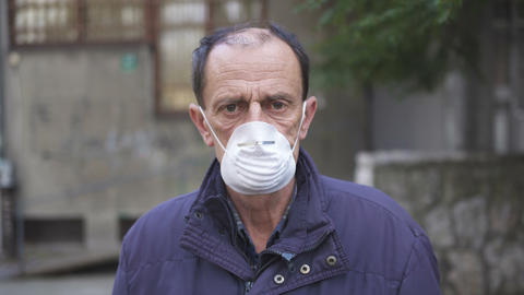 Elderly Man Wearing A Mask Live Action