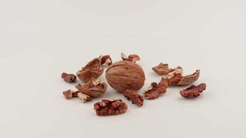 Chopped walnuts on white background. Shelled nuts and shells Live Action