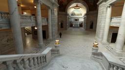 Utah State Capital pan across stairs man walks away HD 4755 Footage