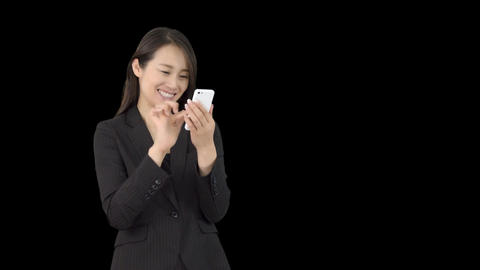 Young Japanese business woman texting on iphone 1 Live Action