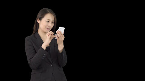 Young Japanese business woman using iphone 1 Footage
