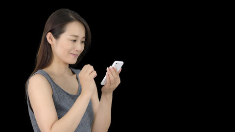 Japanese woman texting on iphone 1 Footage