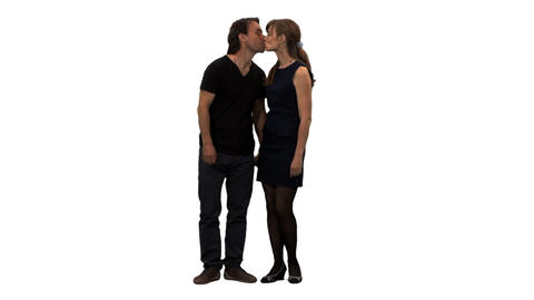 Front view of a loving couple standing and kissing, alpha channel Footage