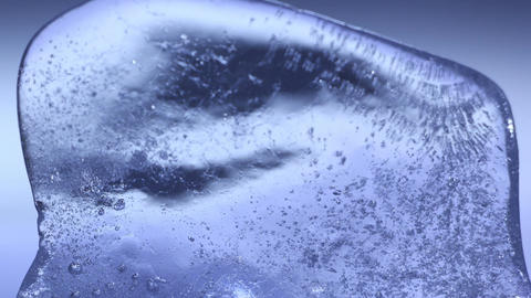 Blue ice thawing close-up timelapse Footage