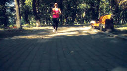 POV woman running toward camera in city slow motion HD video. Female jogging Footage