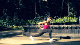 Woman stretching leg muscle park fountain slow motion HD video. Fitness exercise Footage