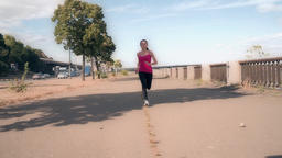 POV woman running toward camera urban city slow motion HD video. Female jogging Footage
